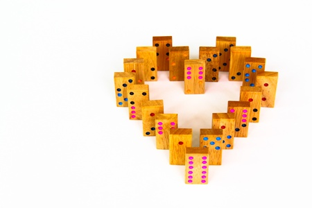 Retro heart wooden dominos isolated on white background photo