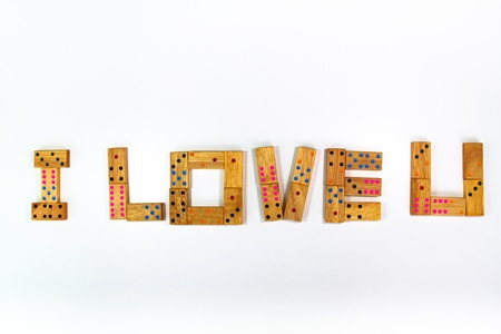 dating strategy: I Love You Retro wooden dominos isolated on white background