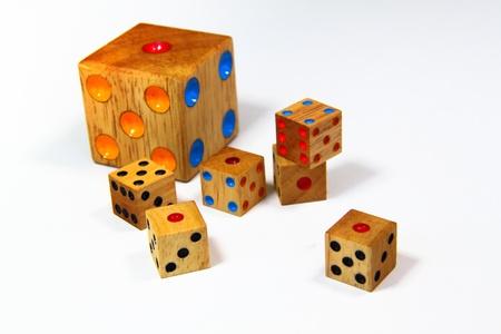 Retro wooden dice isolated on white background photo