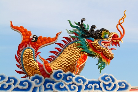 Chinese style dragon statue on white blue sky Stock Photo