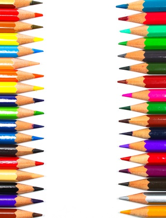 Close up of color pencils with different color over white background photo