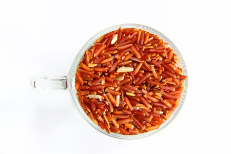 red jasmine rice and beaker on a white background Stock Photo