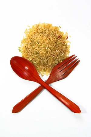 rice and spoon on a white background photo