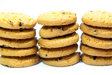 close up of three piles of chocolate chip cookies Stock Photo