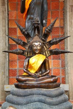 veneration: Buddha statue Seven Naga on heads