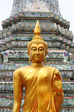 GOLDEN BUDDHA STATUE, WAT ARUN BANGKOK IN THAILAND