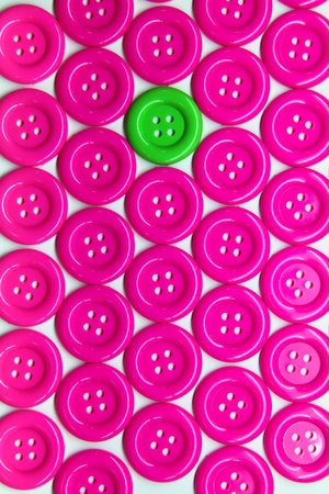 Pattern of green buttons with in pink buttons on white background Stock Photo