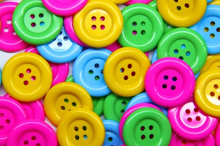close - up of a pile of buttons of many colors photo