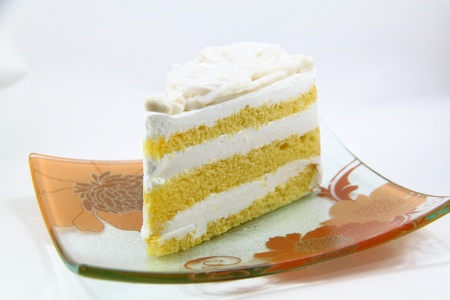 A piece of coconut cake on white background Stock Photo