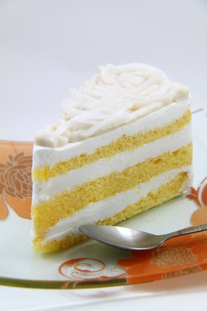 A fresh slice of coconut cream cake Stock Photo