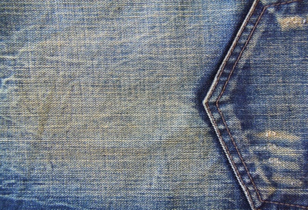 Texture of blue jeans with pocket detail stitching photo
