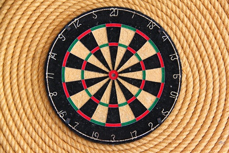 Dart board with twisted ship rope background photo