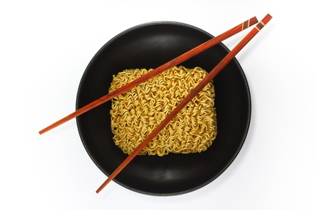 Black bowl of instant noodles, with chopsticks photo