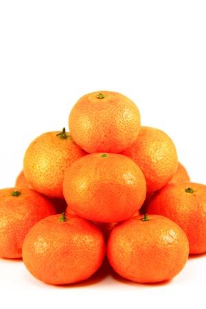 Pile of fresh mandarin, isolated on a white background photo