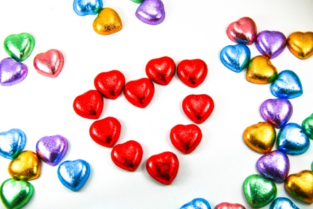 Chocolate heart candies on white background