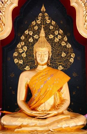 idolatry: Thai Buddha Golden Statue, Wat Tham Khuha Sawan in Thailand Stock Photo