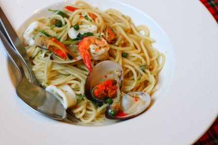 Freshly cooked plate of Stir fried spicy spaghetti with seafood photo