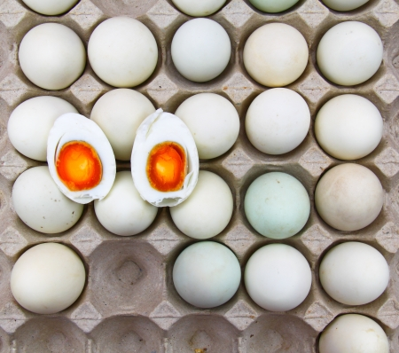 eggs salted cut in half on egg tray Stock Photo