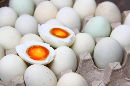 eggs salted cut in half on egg tray photo
