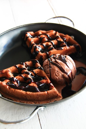 ice cream scoop decorated with waffle and chocolate sauce photo