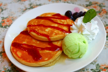 Pancakes with raspberry jam and mint photo