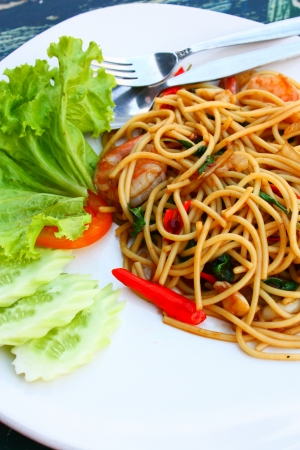 Spicy seafood spaghetti with many kind of herbs photo