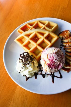 waffle with scoop of vanilla ice cream