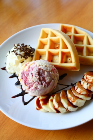 waffle with scoop of ice cream with whipped cream