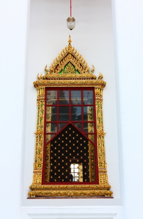 window thai temple, Wat Ratchanatdaram Worawihan Bangkok in Thailand Stock Photo