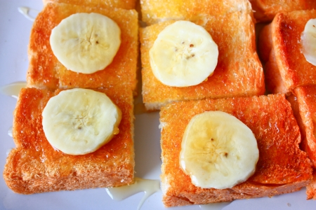 Banana and honey toast on plate