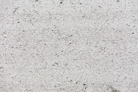 White stucco wall background. White painted cement wall texture.