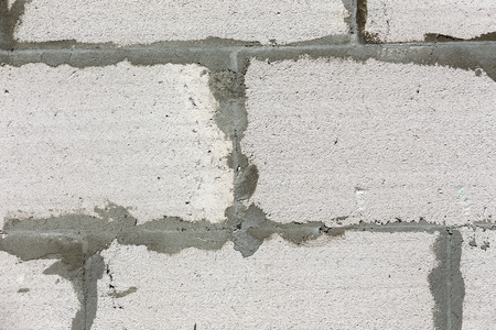 Background from white brick building or construction material.