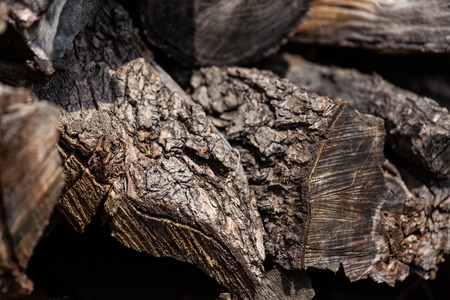 Background from stacked old brown stab wooden logs