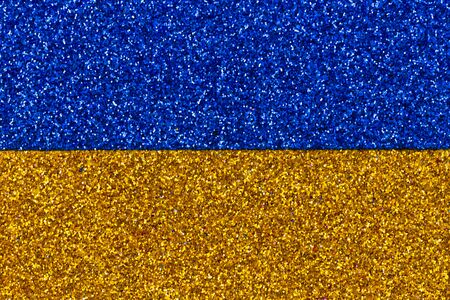 Blue and yellow abstract patriotic background, festive image with defocused glitter effect. Close up photo of blue and yellow abstract patriotic.