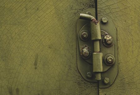 Metal door with bolt in grungy style with copy-space.