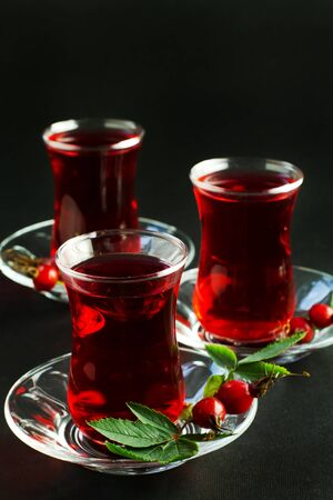 Herbal tea in turkish traditional tea glasses on a black background Stock Photo