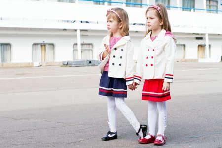 Two little happy girls in port