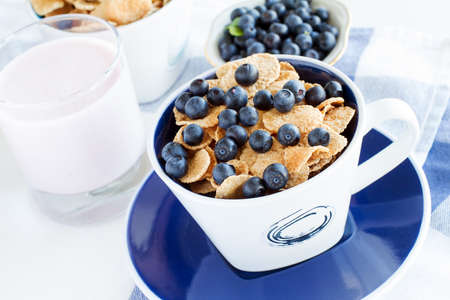 healthy breakfast: cornflakes with fresh blueberries