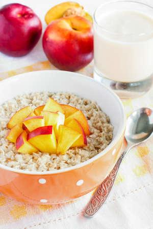 breakfast with porridge, nectarine and yogurt