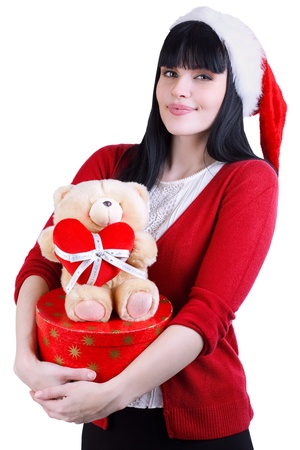 pretty girl in red hat with teddy bear and box on white photo