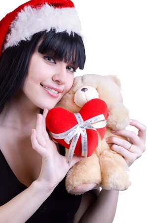 portrait of pretty girl in red hat with teddy bear on white photo