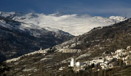alpujarra: White towns under snowcovered hight mountains Stock Photo