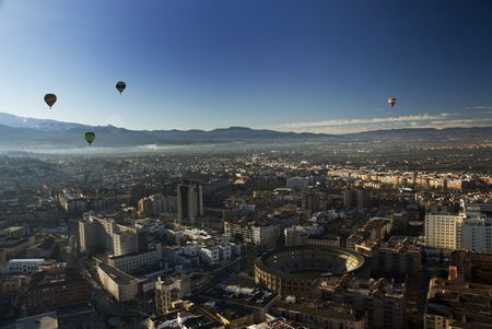 bull fight: Aerial view of Granada city above bull fight square with hot air ballons Stock Photo