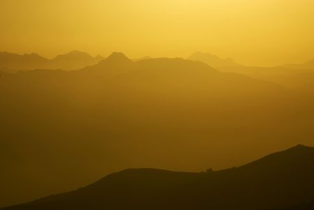 ridgeline: Smoky gold gradiant at mountain sunset