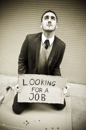 Young businessman holding sign Looking for a job photo