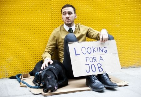 Young businessman holding sign Looking for a job Stock Photo - 5895945