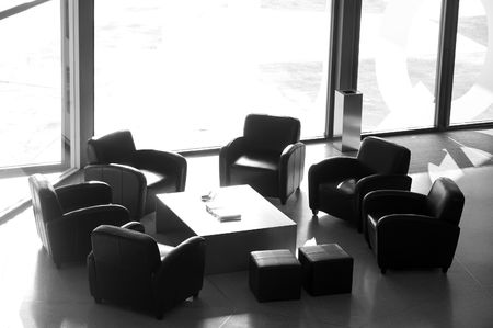 Waiting room with elegant modern black and white design next to a window