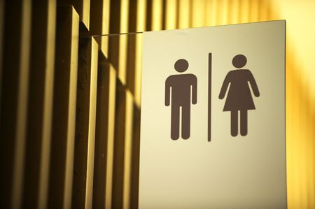 Unisex toilet sign against gold background photo
