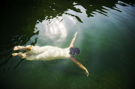 Young woman swimming under water in clear lake Stock Photo - 5895881