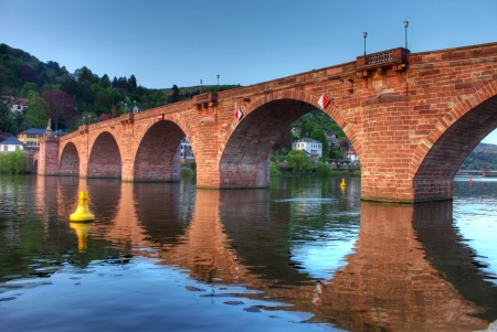 Old bridge on Neckar river in Heidelberg photo